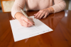 Photodune-13634516-senior-woman-signing-last-will-and-testament-at-home-xs