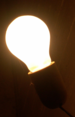 Incandescent_light_bulb_on_db