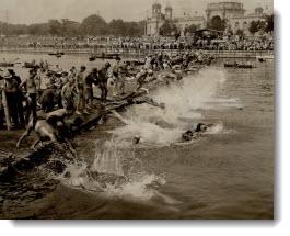 All in at once for the big C.N.E. Swim, Splash. 80 men plunge for the 10-mile marathon swim. 1937