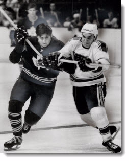 Jim Harrison, Maple Leaf centre, scrambles for puck with Andre Boudrias of St. Louis Blues, 1969
