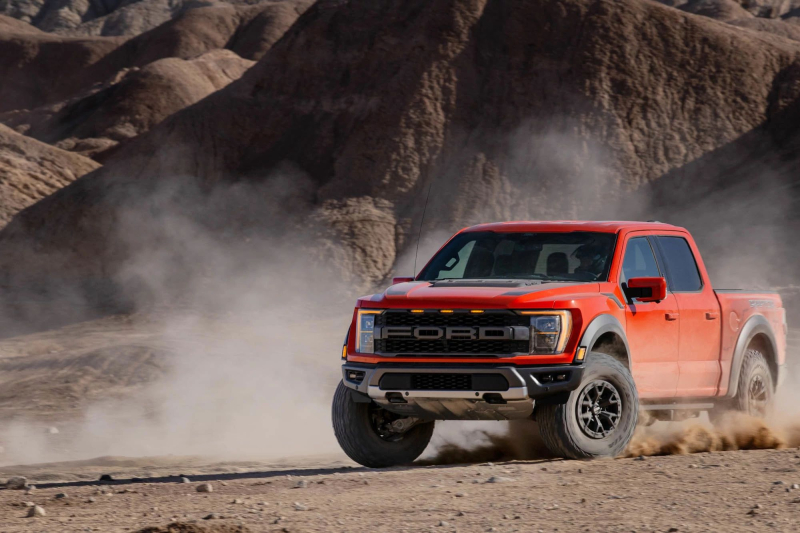 2021 Ford F-150 Raptor Raising Dust In Front of Mountains