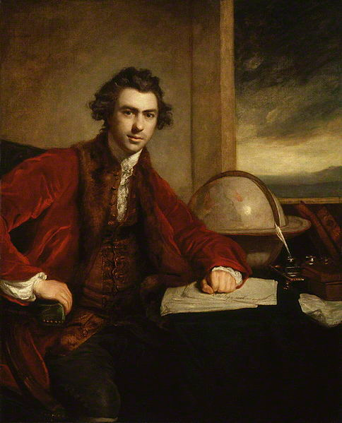Portrait of Joseph Banks seated at a desk with a globe