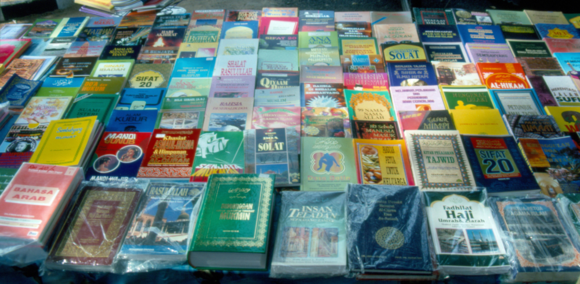 Islamic works on sale in Lorong Kulit market, Penang, with two copies of Sifat 20 visible. Photograph by A.Gallop, 1995.