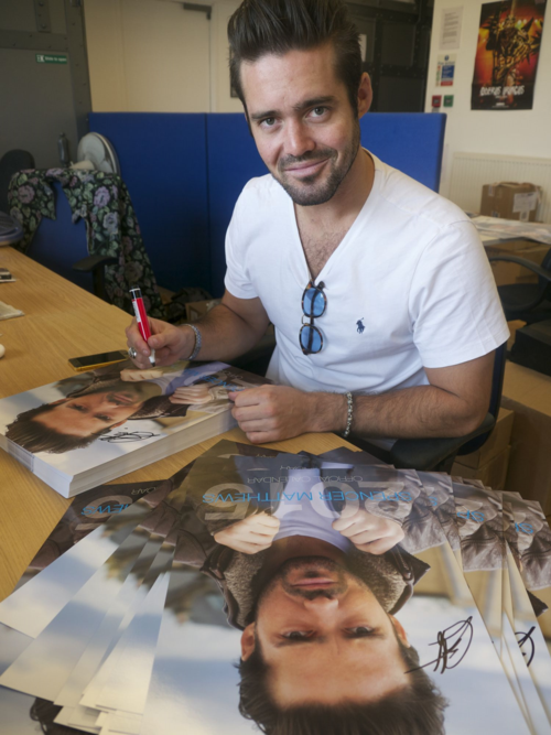 Spencer signing calendars