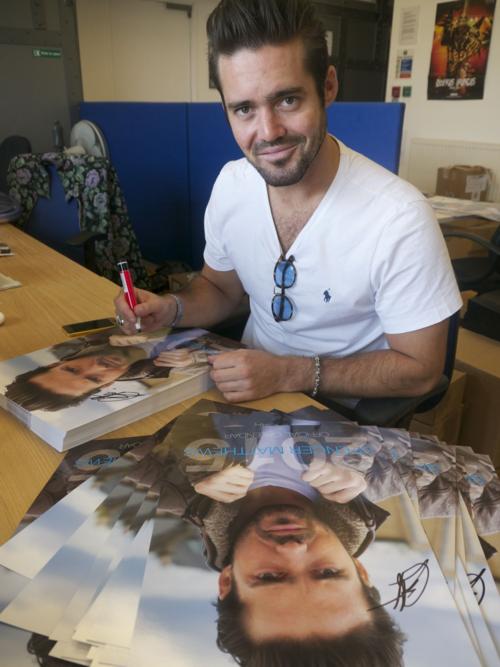 Spencer signing calendars