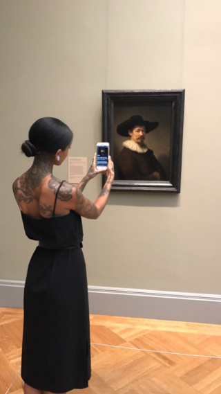 Visitor scanning Rembrandt's portrait of Herman Doomer (c.1595) with Open Access at The Met  NYC  2017