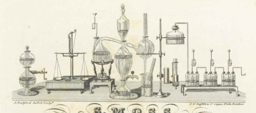a black and white image showing a laboratory scene with various tubular equipment
