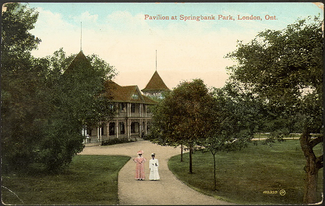 Illustrated postcard of two women walking in a manicured park