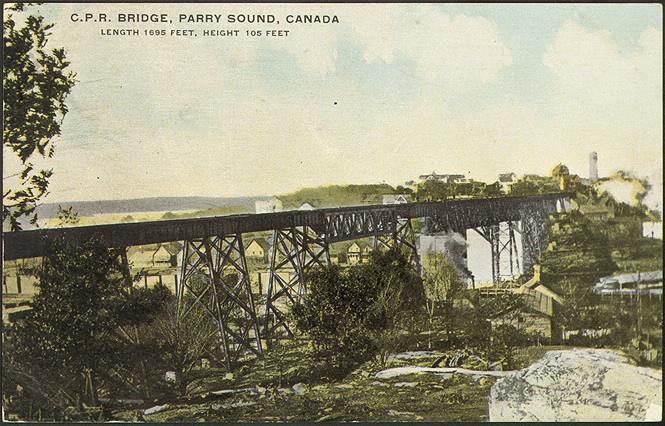 A coloured postcard of a high trestle bridge.