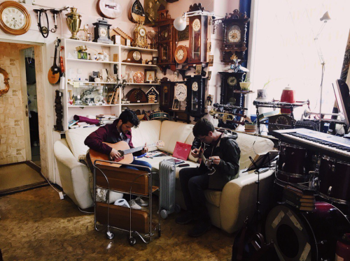 ! Nick Vidal and Eli Kelsey tuning guitars at a local second-hand musical instruments