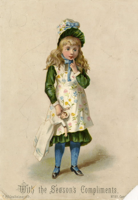 A young girl in a fancy outfit holds a doll against a blank background